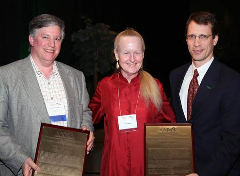 Charles Franklin (left) and Mark Blumenthal receive the Warren Mitofsky AAPOR Innovator's Award from Mitofsky's widow, Mia Mathar, on 05/19/07. Photo by Steve Everett.